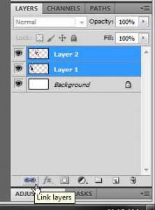 how to link two layers in photoshop cs5