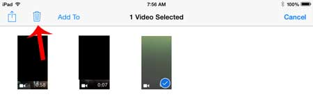 select the video to delete, then touch the trash can icon