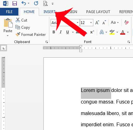 click the Insert tab at the top of the Word 2013 window
