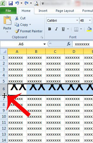 double-click the bottom border of the row number