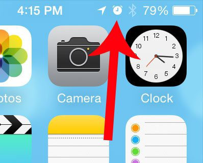 What is the Clock Icon at the Top of My iPhone Screen