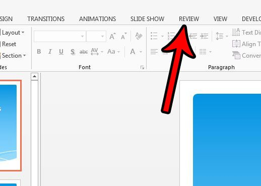 click the powerpoint 2013 review tab